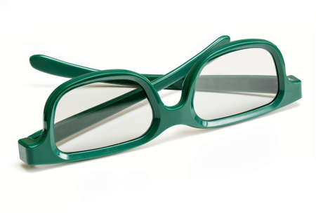 polarised: Pair of green 3d polarized glasses for watching 3-d movies in cinema isolated against white