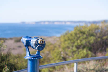 lookout: Blue painted telescope on California coast near Malibu