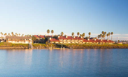 timeshare: Sunset over timeshare development by water in Ventura California with modern homes and yachts boats