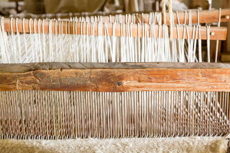 loom: Old weaving loom made from timber making cloth in La Purisima mission California Stock Photo