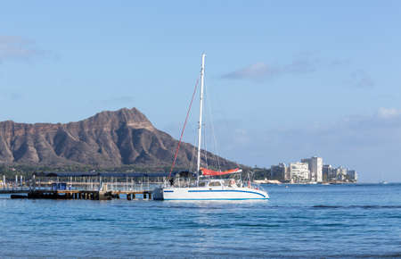 pink cruiser: Boat docked in front of Diamond Head and Waikiki Beach area of Oahu in Hawaii Stock Photo