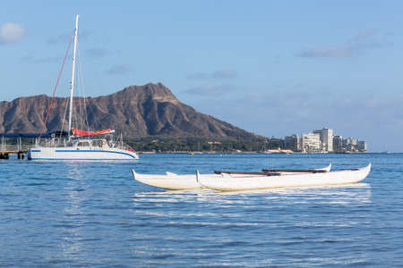 diamond head: Boat docked in front of Diamond Head and Waikiki Beach area of Oahu in Hawaii Stock Photo