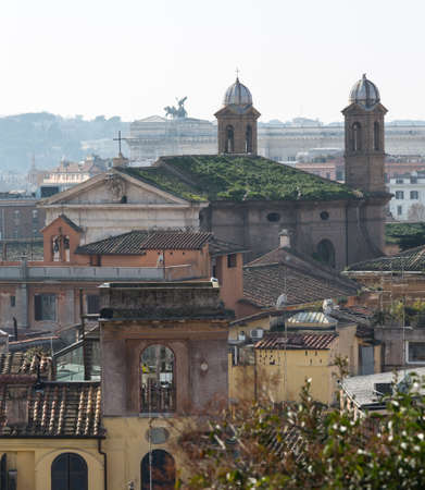 Basilica church with grass on roof in the skyline of Rome Italy with smog in the distance Stock Photo - 17933623