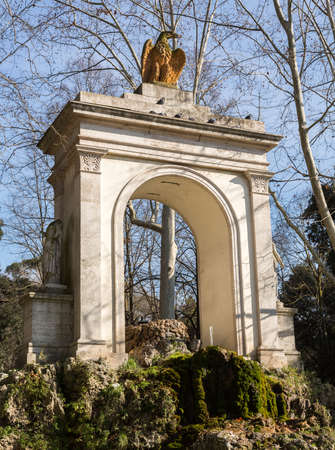 Piazza del Fiocco arch with eagle statue and fountain at entrance to Villa Borghese in Rome Italy in winter Stock Photo - 17933635
