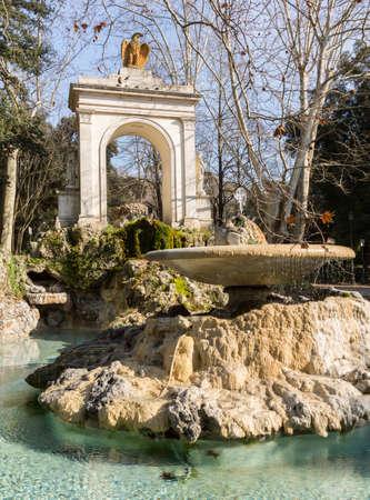 lazio: Piazza del Fiocco arch with eagle statue and fountain at entrance to Villa Borghese in Rome Italy in winter Stock Photo