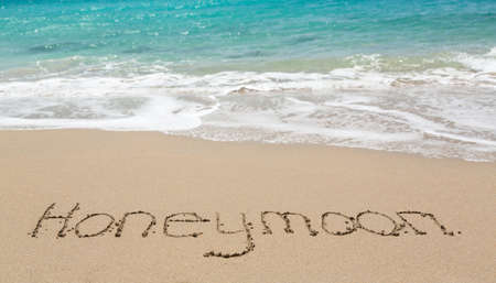Honeymoon words written into sand on beach by sea in St Thomas Banco de Imagens - 18132826