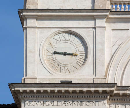 italian architecture: Detail of clock face on Trinita dei Monti church at top of Spanish Steps in Rome Italy