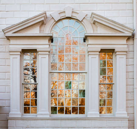 President George Washington home at Mount Vernon in Virginia with view of trees reflected in house windows