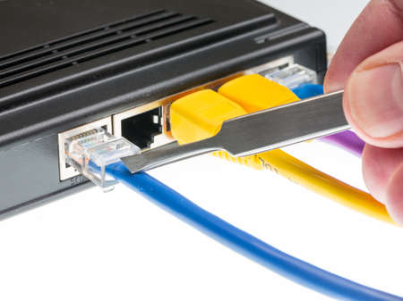 intercept: Close macro focus on internet lan cat5 cables as concept for cyberwarfare