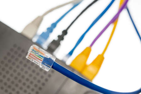 cyberwarfare: Close macro focus on internet lan cat5 cables as concept for cyberwarfare