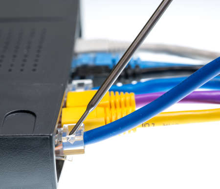 Close macro focus on internet lan cat5 cables as concept for cyberwarfare photo