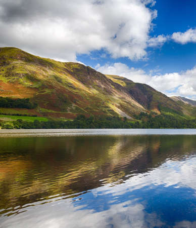 Mountains reflect into Buttermere calm lake in English Lake District Stock Photo - 18564968