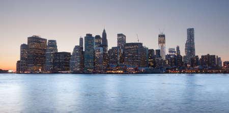 span: Lower Manhattan at sunset taken from side of Brooklyn Bridge Stock Photo