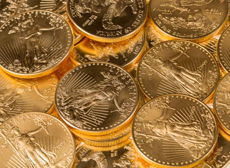 Stacks of gold eagle one troy ounce golden coins from US Treasury mint photo