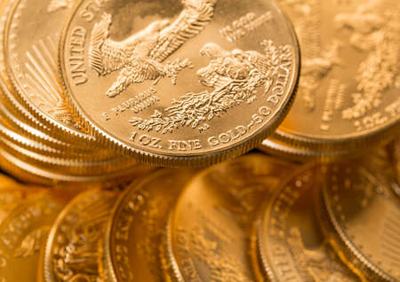 ounce: Stacks of gold eagle one troy ounce golden coins from US Treasury mint