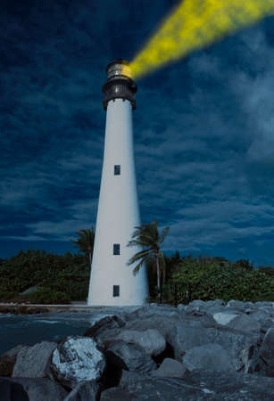 bill baggs: Cape Florida Lighthouse and Lantern in Bill Baggs State Park in Key Biscayne Florida with light glowing at night