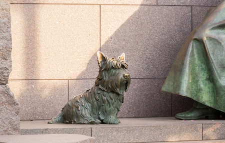 roosevelt: Detail of pet dog by statue in memorial monument to President Franklin Delano Roosevelt in Washington DC