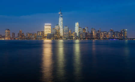 full height: Skyline of lower Manhattan of New York City from Exchange Place at night with World Trade Center at full height of 1776 feet May 2013 Stock Photo
