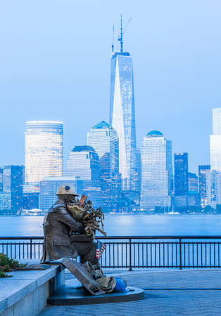 JERSEY CITY, NJ, USA - 22 MAY: Firefighter 9-11 Memorial Statue at Exchange Place on 22 May 2013. The statue was recovered from World Trade Center site and is by Seward Johnson