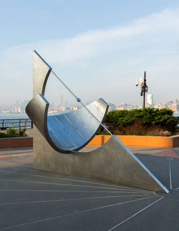 JERSEY CITY, NJ, USA - 22 MAY: Equatorial Sundial in Jersey City in front of midtown New York on 22 May 2013. The sundial was designed by Robert Adzema