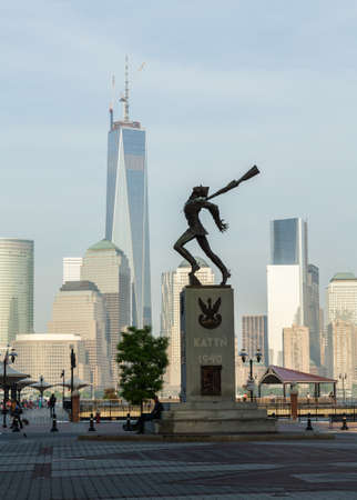 JERSEY CITY, NJ, USA - 22 MAY: Katyn Memorial in Jersey City in front of newly built World Trade Center on 22 May 2013. The statue was unveiled in June 1991