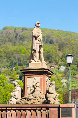 theodor: Statue of Karl Theodor from 1792 one of elector builders of old bridge leading to ancient town city of Heidelberg Germany Stock Photo