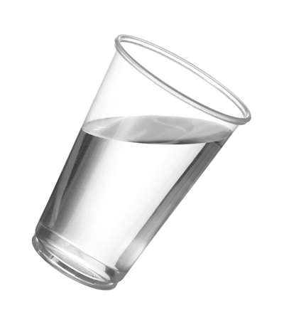 Pure drinking water in disposable cup or glass with water starting to spill over edge of pint glass photo