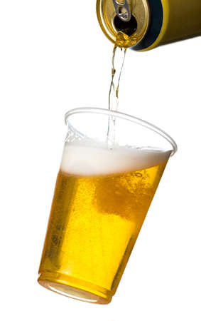 overflow: Golden beer, ale or lager in a tilting plastic disposable cup or glass with beer being poured from can and spilling over edge of pint