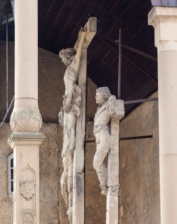 crucifixes: Side view of the ancient stone carved crucifixes in Bad Wimpfen, Germany. This Crucifixion group is the work of Mainz sculptor Hans Backoffen in about 1515.