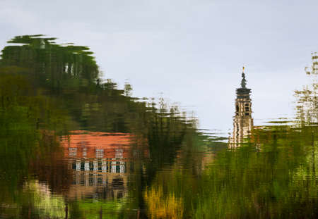 johannes: Evangelical Lutheran church of St Johannis or Johannes in small Bavarian village of Castell in Germany. Church and castle or schloss is reflected in the rippled water of the village pond
