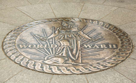 memorial plaque: Tourists walking across seal at the World War II Memorial in Washington DC