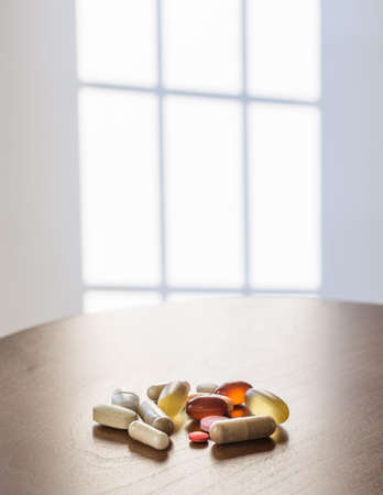 Collection of different colors and sizes of vitamins and supplements taken with breakfast for healthy lifestyle Stock fotó