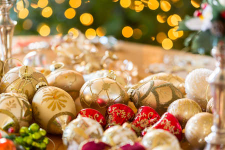 put away: Christmas xmas decorations in macro waiting on table to be put on tree or put away
