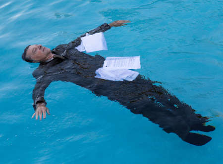 Senior Caucasian Businessman In Suit Sinking Underwater Deep Stock Photo Picture And Royalty Free Image 22010699