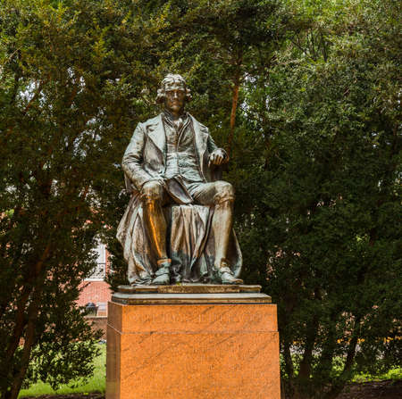 CHARLOTTESVILLE, VA - AUGUST 28: Statue of Thomas Jefferson on the campus of University of Virginia on 28 August 2013. Designed by Thomas Jefferson as an Academical Village Editorial