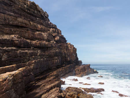 Rocky shoreline at Cape of Good Hope South Africa photo
