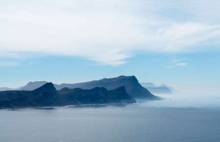 cape of good hope: Rocky shoreline view from Cape Point near Cape Town South Africa Stock Photo
