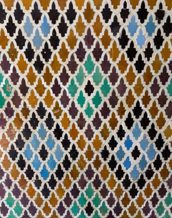 mosaic: Oriental pattern mosaic of tiles in a mosque in Morocco forming diamond shapes Stock Photo
