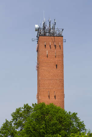 Tall brick telecoms tower in Wayne Pennsylvania used for radio masts for cellphone mobile telephones