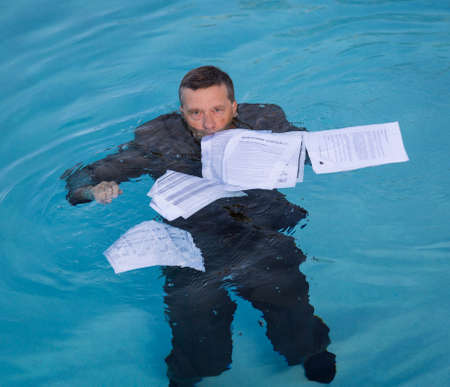Senior Caucasian Businessman In Suit Sinking Underwater Deep Blue Pool Worried About Being With