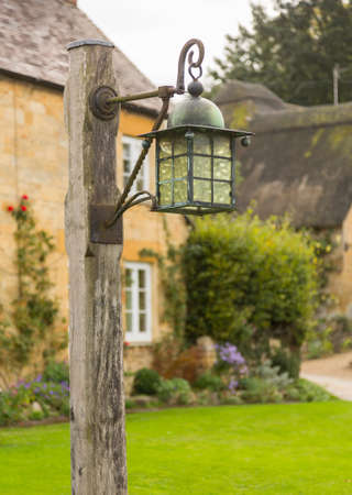 old english: Street lamp in the village of Stanton near Stanway. Cotswold or Cotswolds district of southern England in the autumn.