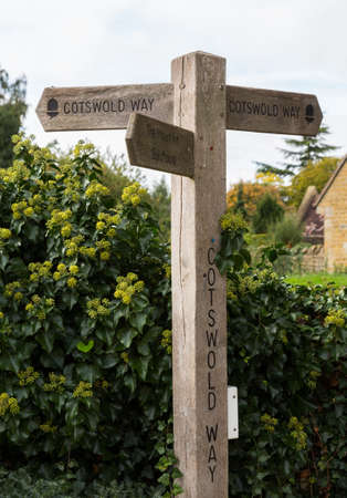 old english: Signpost for Cotswold Way long distance path in Cotswold or Cotswolds district of southern England in the autumn.