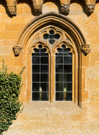 Ornate church window in Stanway in Cotswold or Cotswolds district of southern England in the autumn. photo