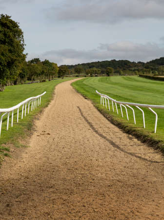 Horse riding stables for training race horses in Cotswold or Cotswolds district of southern England in the autumn. Banco de Imagens