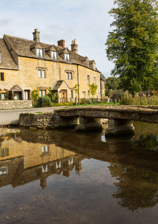 Lower Slaughter with river in Cotswold or Cotswolds district of southern England in the autumn. photo