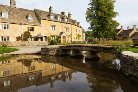cotswold: Lower Slaughter with river in Cotswold or Cotswolds district of southern England in the autumn.