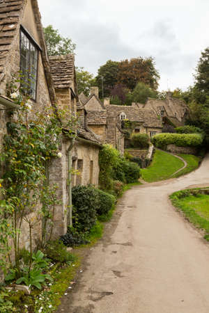 Arlington Row in Bibury in Cotswold or Cotswolds district of southern England in the autumn. photo