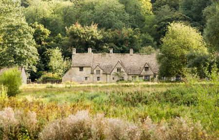 almshouse: Arlington Row in Bibury in Cotswold or Cotswolds district of southern England in the autumn.