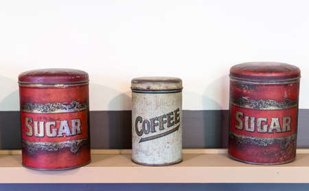 Three tins on shelf in pantry holding coffee and sugar from victorian era photo