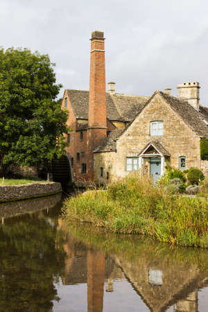 Lower Slaughter with river in Cotswold or Cotswolds district of southern England in the autumn.
